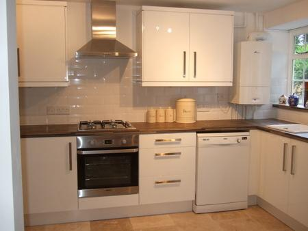 The kitchen has a dishwasher and laundry area. - Stable Cottage - Freshford - rentals