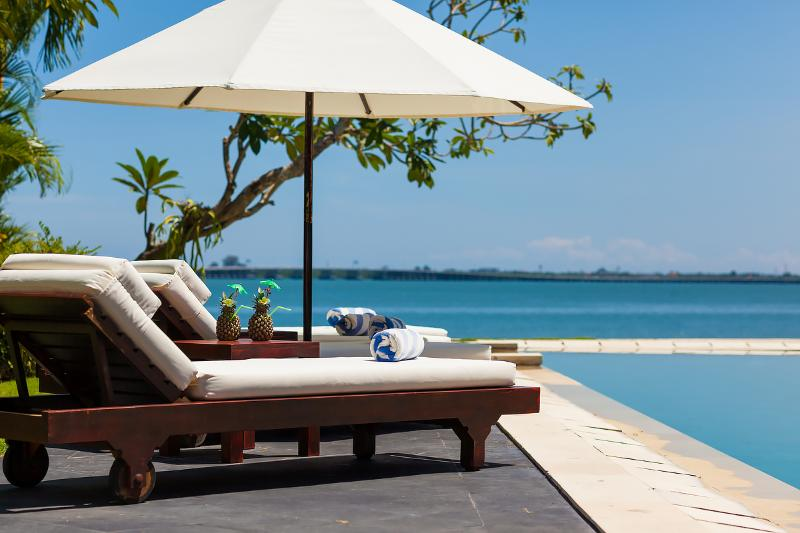 Sun loungers by the pool - Waterfront villa Sunset. HOT 1-, 2- & 3-bdr rates. - Nusa Dua - rentals