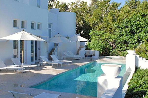 Terraces open to the infinity edge pool, and the ocean beyond. This house embraces the generous natural light. RIC SND - Image 1 - Anguilla - rentals