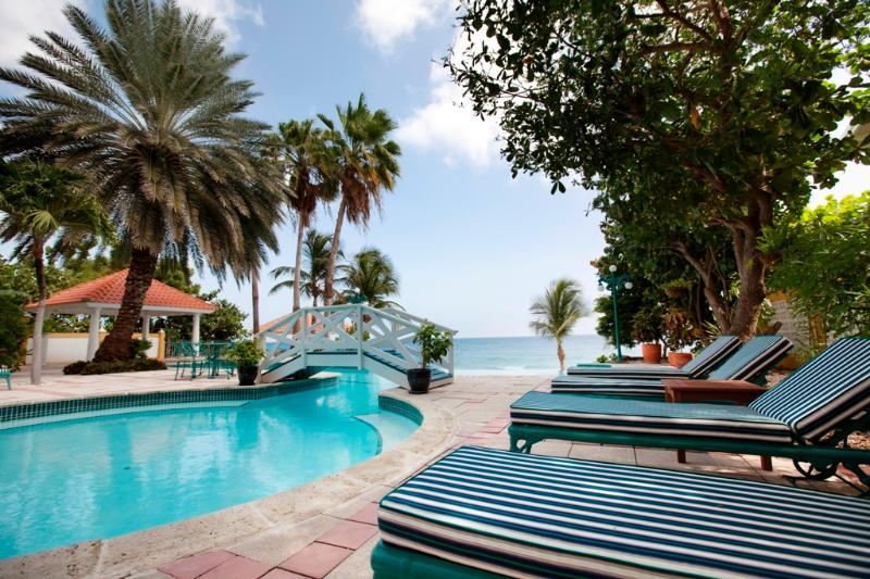 Estate on a beautiful beachfront location with swaying palms and white sand - Caribbean Heaven - Image 1 - Willemstad - rentals
