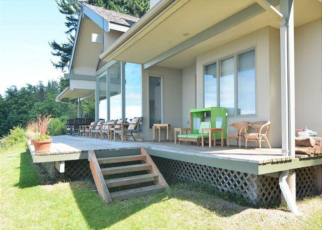 Deck offers dining table, lounge seating, and BBQ. - North Shore Reef on Orcas Island - Eastsound - rentals