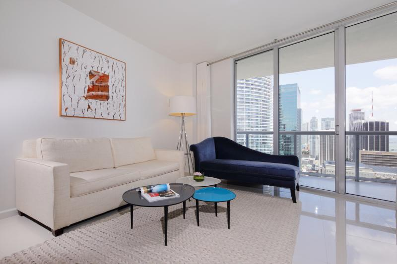 Living room, original art paintings, sofa is queen size bed - Property 1923444 - Brickell - rentals
