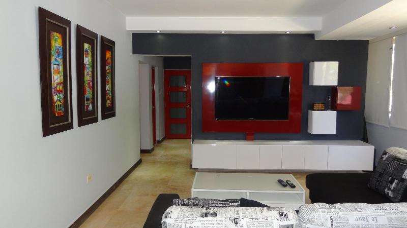 Family room and entertainment center - Recently Updated, Stylish and Beautiful 3 bedrooms - San Juan - rentals