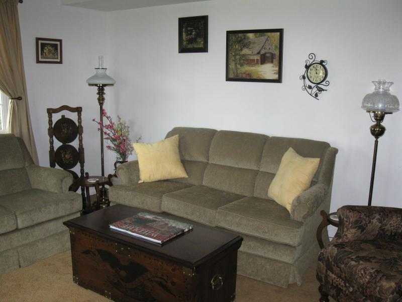 Living Room boasts a recliner, stuffed chair, love seat, and couch. Cable TV & DVR - APPLEWOOD'S A+ GETAWAY - Normalville - rentals