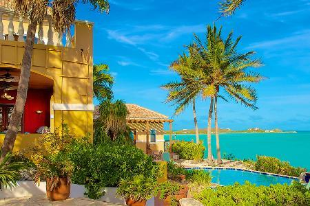 Beachfront Three Cays Villa, gated with lush gardens, natural sea reefs & pool - Image 1 - Turtle Tail - rentals