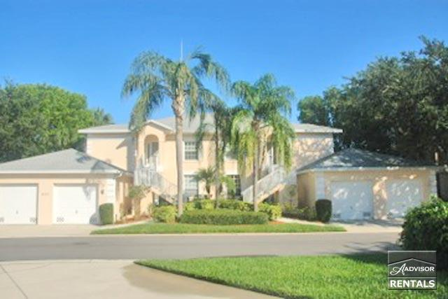 Delightful lake view 1st floor, end unit condo in the energetic and friendly complex of Wiggins Lakes and Preserves. - Image 1 - Naples - rentals