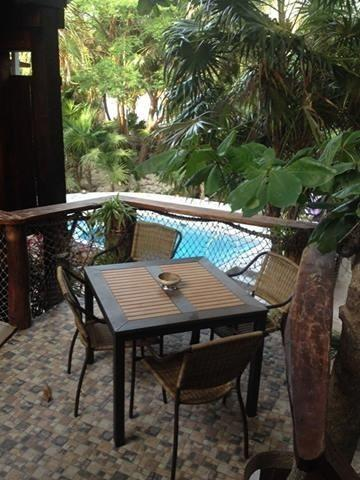 View from second story shaded deck - SANDCASTLE - J & S guest house apartment - Caye Caulker - rentals