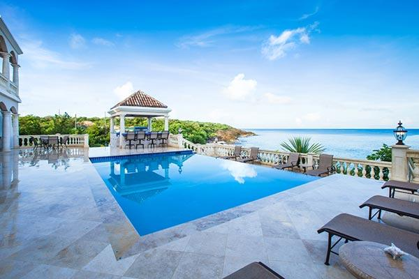 The Grand Master bedroom of this villa includes a private shower and large outdoor balcony overlooking the beach and sea. RIC SAN - Image 1 - Anguilla - rentals