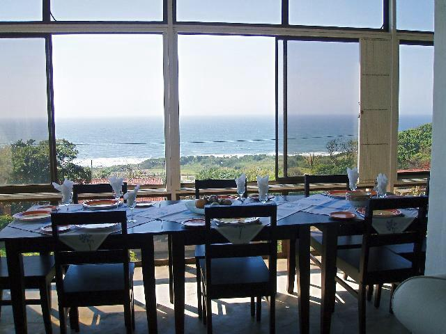 Dinning Area - Overlooking the Main Beach and RockPool - Beach House.  Seacottage       Self catering.    O - Hibberdene - rentals