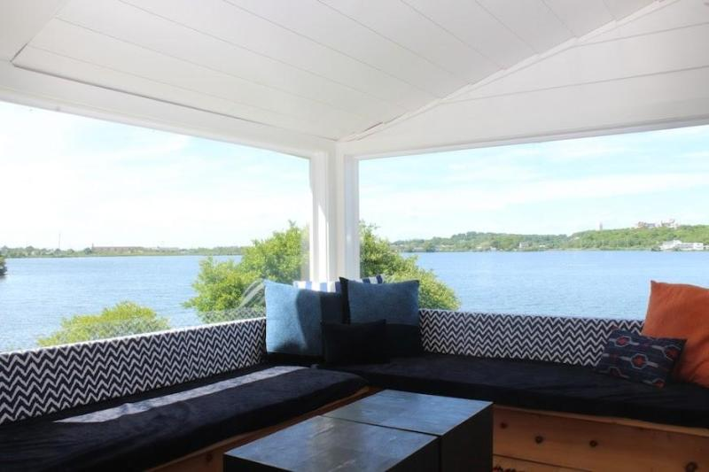Large vista windows over the lake looking out toward Surf Lodge across Fort Pond - Waterfront Cottage on Fort Pond, Montauk - Montauk - rentals