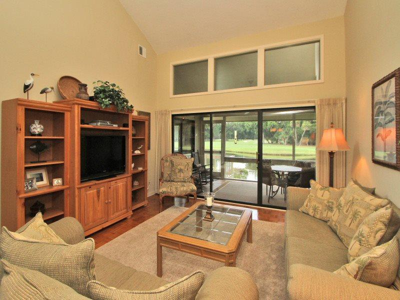Living Room with Screen Porch Access at 553 Ocean Course - 553 Ocean Course Villa - Sea Pines - rentals