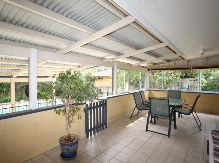 Patio  BBQ Area Overlooking Pool - Brisbane Family Holiday Home with Pool - Brisbane - rentals