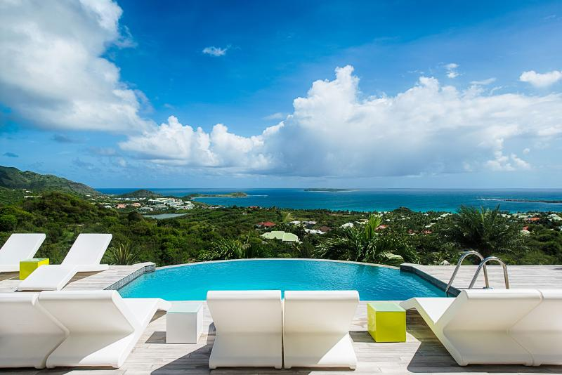 Turquoze, a beautiful contemporary 4 bedroom home nestled in the hills above Orient Bay. - Image 1 - Orient Bay - rentals