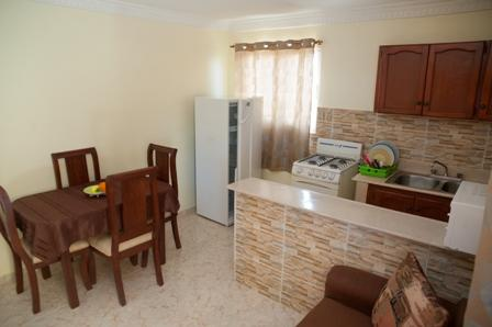Equipped kitchen, kitchenware and seating area - One-Bedroom Apartment - Sleeps 4 - Santo Domingo - rentals