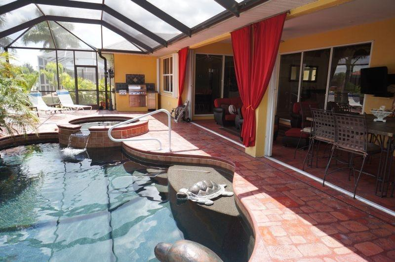 Villa Cecilia - Cape Coral 3b/2ba luxury home with electric heated pool/spa on gulf access canal, HSW Internet, Boat Dock - Image 1 - Cape Coral - rentals