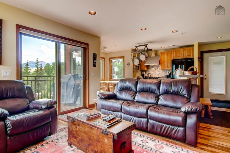 The living room receives tons of natural light through the windows and glass doors. - So good it should be illegal - Gourmet kitchen and BBQ, close Gondola access - Outlaws Hideaway - Mountain Village - rentals
