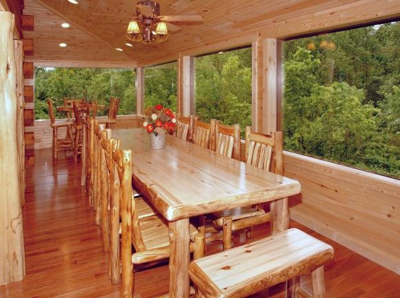 table for 12-14 in glasssed porch - $395 wkdays til 5/22-STUNNING FAMILY REUNION CABIN - Sevierville - rentals
