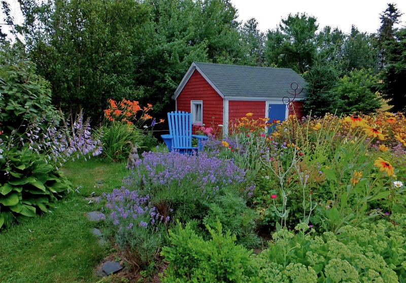 The July garden, adjacent to the house. Outbuilding in background. - Best kept secret in Nova Scotia - Lunenburg - rentals