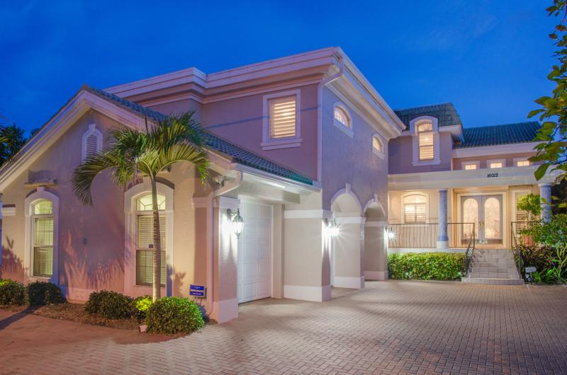 Front entrance w 3 car garage, lots of parking, has orange and grapefruit trees - BEACH BLISS ESTATE-PRIVATE BEACH, POOL & ELEVATOR - Redington Beach - rentals