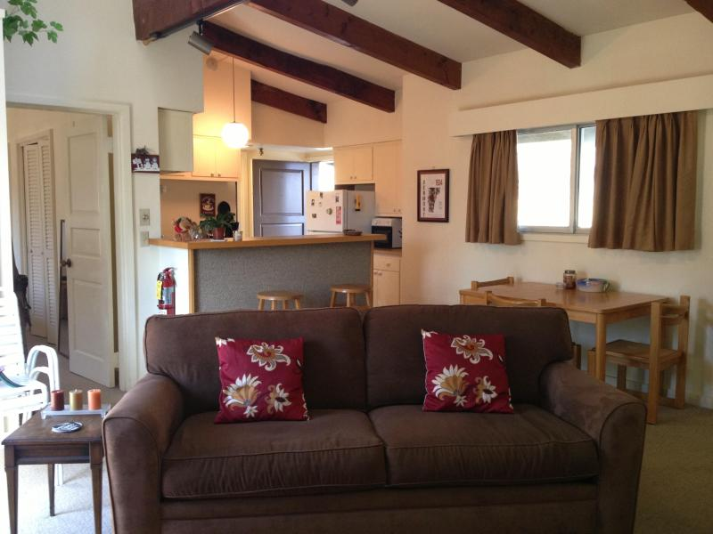 Living room w/ wood beams and lots of light - Comfortable Sugarbush retreat w/ mountain views - Warren - rentals