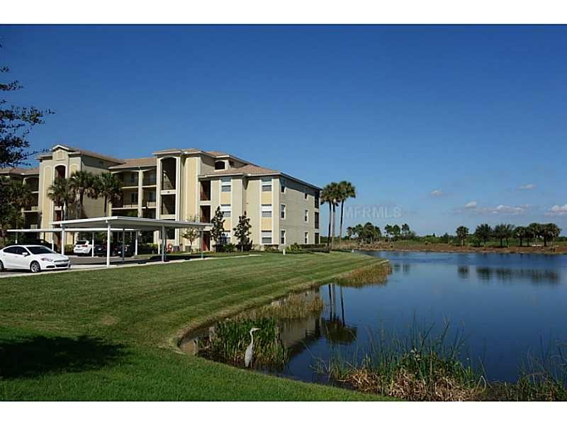 Beautiful main floor end unit with lake and golf course views - River Strand -Golf , Tennis, Sunsets and  Beaches - Bradenton - rentals