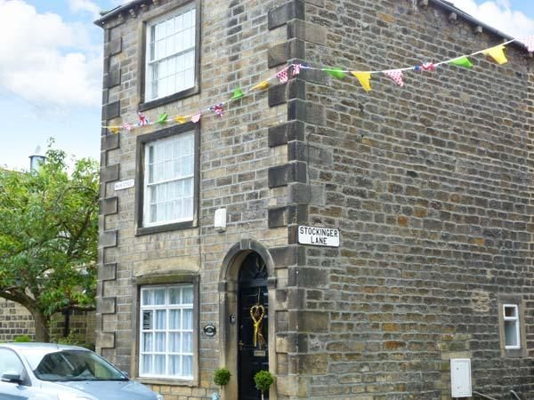 CHRISTMAS COTTAGE, feature beams and stonework, woodburning stove, WiFi, centre of Addingham, Ref 29732 - Image 1 - Addingham - rentals