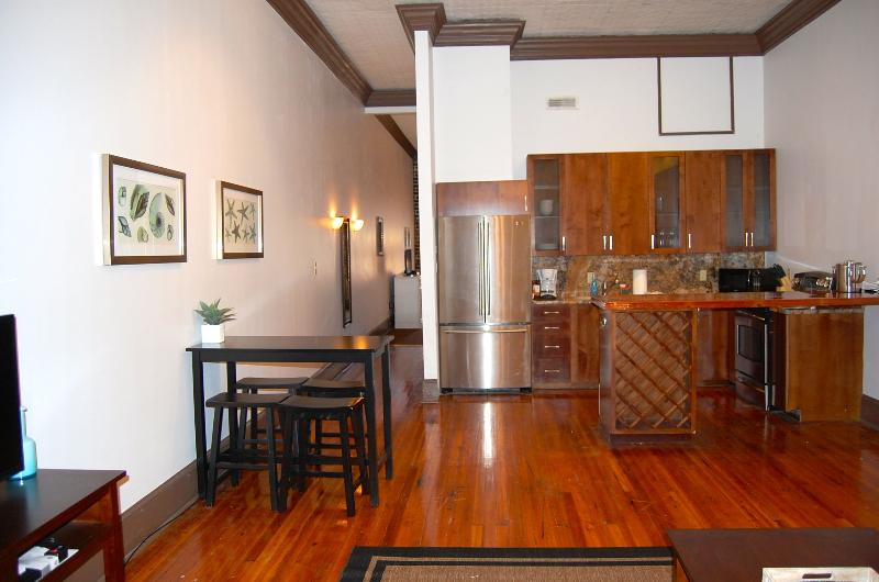 Spacious Living Room & Kitchen Area - Telfair Loft 214: Steps from City Market + River! - Savannah - rentals