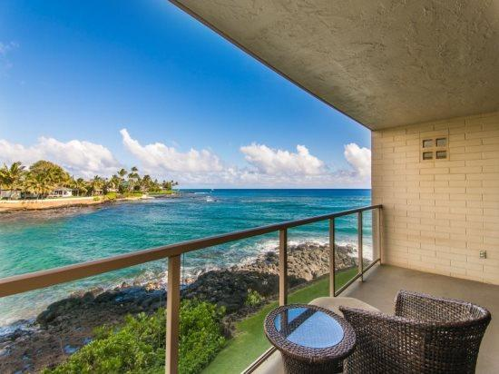 lanai - Free Car* with Kuhio Shores 207 - Spectacular remodel on this oceanfront 1bd with awesome ocean views. Watch the sea turtles from your lanai. - Poipu - rentals