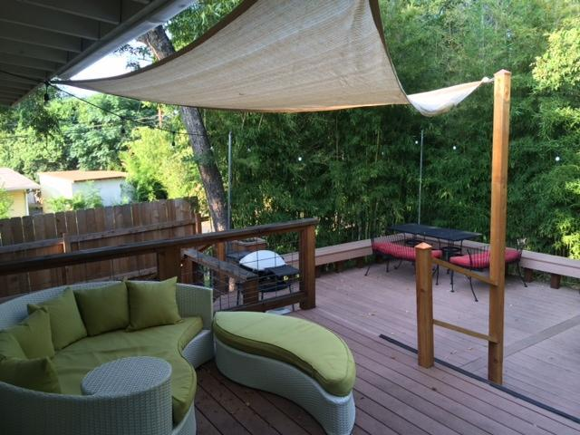 Beautitful back patio, surrounded in bamboo with string lighting - The Westrock: 3/2 house in Barton Hills with deck! - Austin - rentals