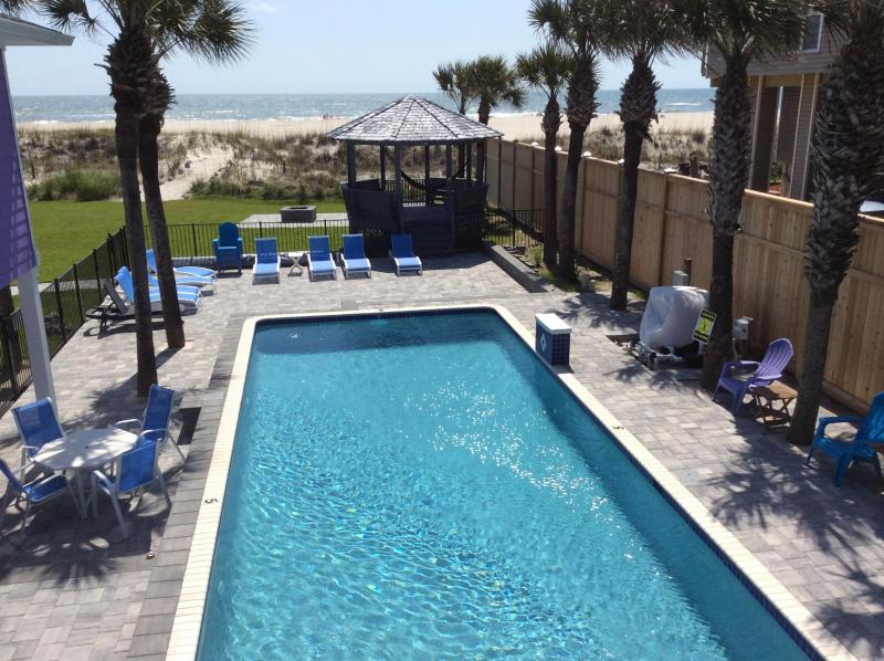Large lap pool 5' deep.  Lay poolside with your umbrella drink under one of 26 palm trees. - Oceanfront Pool Vacation Rental 5 Master Suites - Saint Augustine Beach - rentals