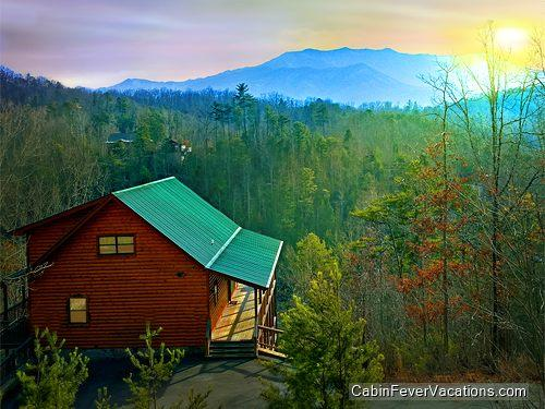 Log cabin exterior and view at sunset. - Bear Hunter - Sevierville - rentals