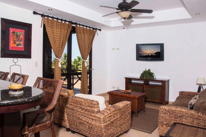 Main living area with flat screen TV and balcony access - Bahia Encantada 3E 3rd Floor Garden View - Jaco - rentals