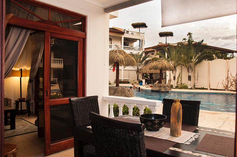 The patio dining area offers a fabulous view of the main pool and waterfall. - Paloma Blanca 1B 1st Floor Pool View - Jaco - rentals