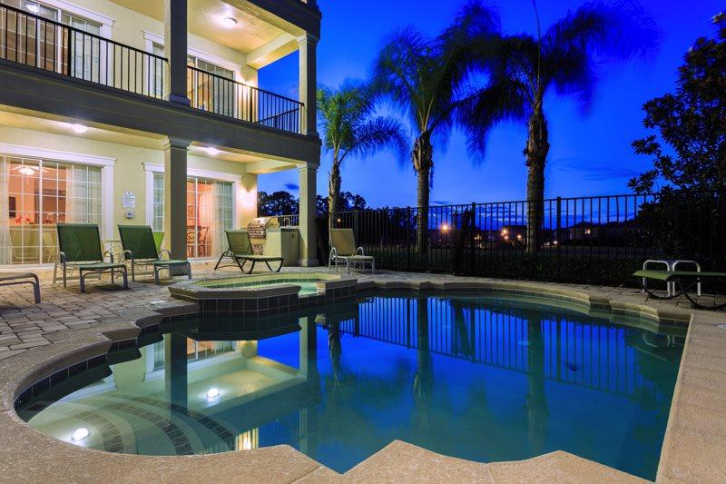 Relax in the beautiful pool any time of day or night - Reunion Palace | Expansive Luxury Villa with 3 Floors, Pool Table, Air Hockey, & 3 Unique Arcade Games - Kissimmee - rentals