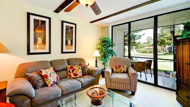 Living room and screened lanai overlook natural pond - Turtle Cove- A+Rated Resort Villa near Beach & IMG - Bradenton - rentals