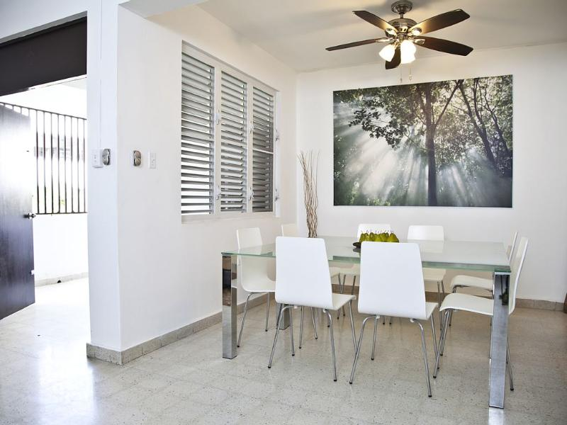 Dining area seats 8 and looks out to a large private balcony. - Beach Bungalow V - Condado, Puerto Rico - Exclusive Areas Beaches & Casinos! - San Juan - rentals