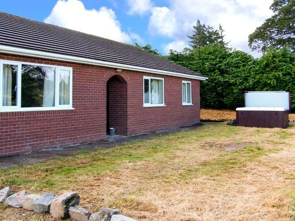 GLANYRAFON BUNGALOW, detached, all ground floor, hot tub, pool table, parking, garden, in St Harmon, Ref 29854 - Image 1 - St Harmon - rentals