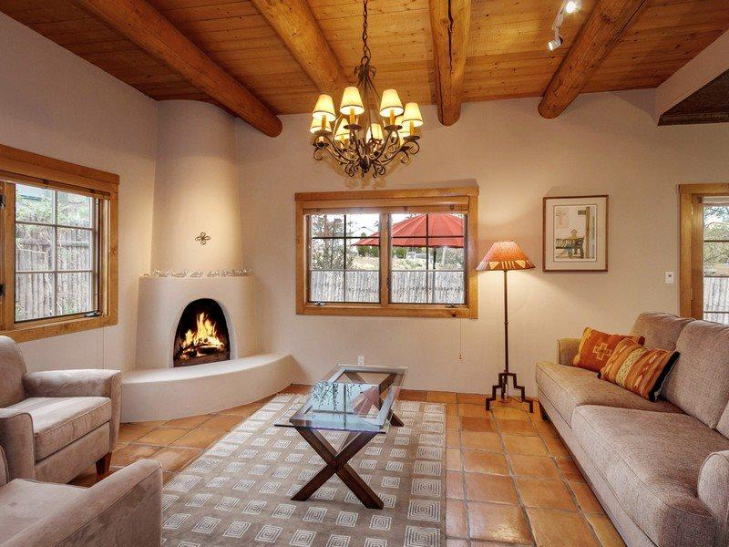 Living room with kiva fireplace and flat screen TV - Two Casitas - Rosario - Impeccable and alluring. Short stroll to the Plaza - Santa Fe - rentals