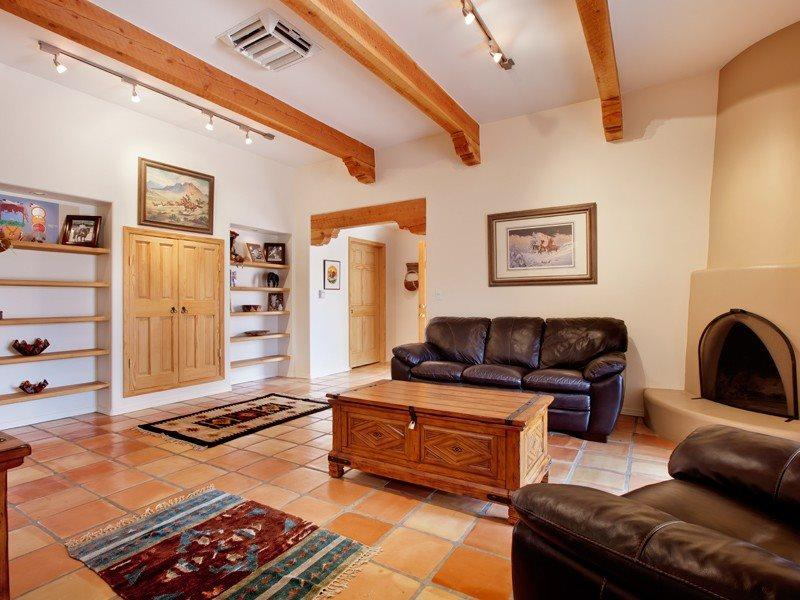 Living room of Don Canuto with working, kiva fireplace and flat screen TV - Two Casitas- Don Canuto -Perfect Home, Perfect Price - Santa Fe - rentals