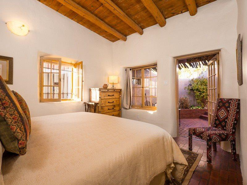 Reposada- bedroom with king bed and exit to patio - Two Casitas - Reposada - Old World Charm! Walk everywhere! - Santa Fe - rentals