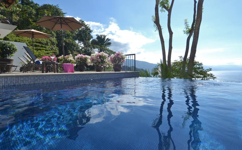 Extensive sunbathing terrace with infinity pool and stunning bay views - Magnificent Villa-Unequaled Luxury, Views & Staff - Puerto Vallarta - rentals