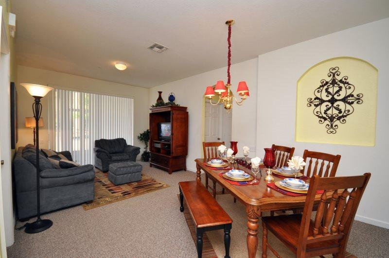 Enjoy the open plan layout with access to the patio  - Castaway Condo | 3 Bed Condo | Windsor Hills Resort - Kissimmee - rentals
