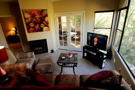 Living room with flat screen TV and mountain views - Three Bedroom Condo with Awesome Mountain Views at Canyon View in Ventana Canyon - Tucson - rentals
