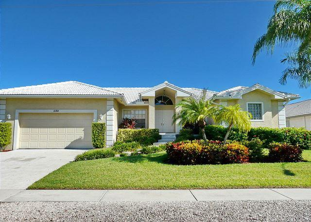 Pet-friendly waterfront home with all-tile interior and heated pool - Image 1 - Marco Island - rentals