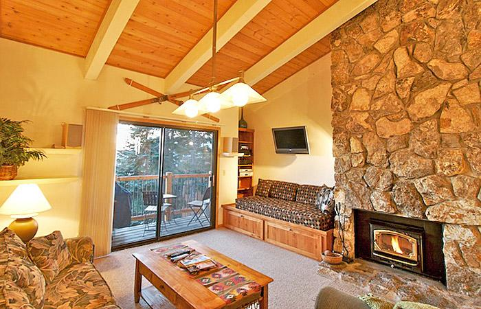 Timber Ridge #24 Living Area With A Wood Burning Fireplace and A Double Sofa Bed - Timber Ridge 24 - Mammoth Ski in Ski out Condo - Mammoth Lakes - rentals