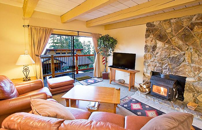 Timber Ridge #27 Living Area With A Wood Burning Fireplace And A Queen Aerobed - Timber Ridge 27 - Mammoth Ski in Ski out Rental - Mammoth Lakes - rentals