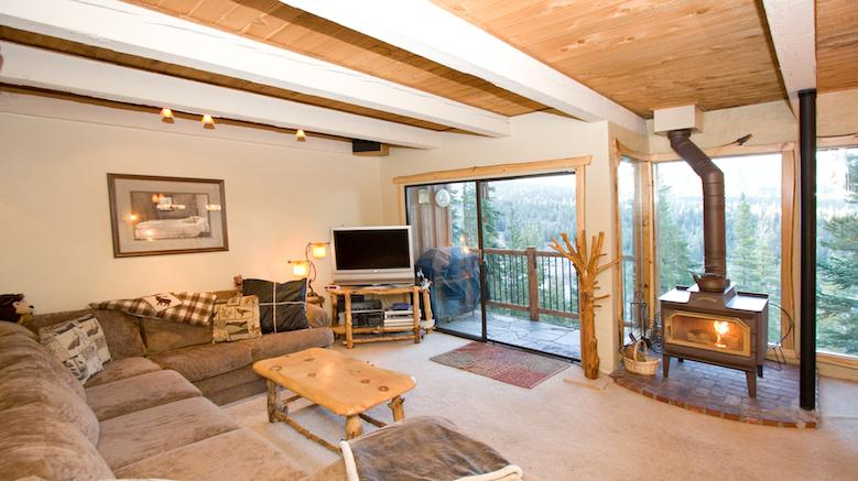 Timber Ridge #45 Living Area With A Wood Burning Fireplace and Floor To Ceiling Windows - Timber Ridge 45 - Ski in Ski out Mammoth Condo - Mammoth Lakes - rentals
