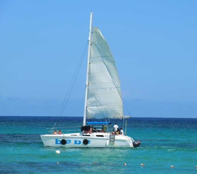 Watch or participate in a catamaran excursion from the beach - Beach Residency ocean view 2BR steps from beach! - Bavaro - rentals