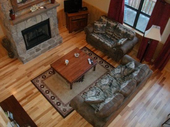 The Living Room of Wolf Ridge from Above - Wolf Ridge – Secluded Log Cabin - Enjoy the outdoors through Large Windows – Indoor Jetted Tub -- Hiking at the Cabin - Bryson City - rentals