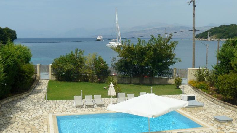Avlaki beachfront villa with pool in Kassiopi - Image 1 - Avlaki - rentals